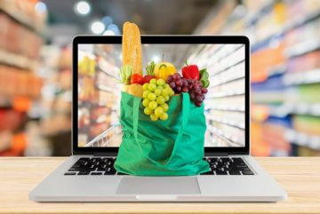 bag-full-of-groceries-sitting-on-a-laptop-keyboard